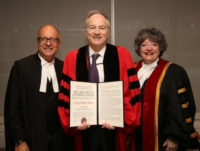 The Hon. George W. Adams, QC (centre), holds the honorary Doctor of Laws (LLD) degree presented to him by The Law Society of Upper Canada at its Jan. 29th Call to the Bar ceremony at Roy Thomson Hall in Toronto. Mr. Adams is congratulated by Law Society CEO Robert G.W. Lapper, QC (left) and Law Society Treasurer Janet E. Minor (right). (CNW Group/The Law Society of Upper Canada)