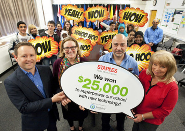 Moe Sandouga (second from the right), general manager of the Edmonton Staples store, Irene Palumbi (right), Staples district manager, announce to Sue Bell (second from the left), principal, and Aaron Dublenko (left), teacher, that Queen Elizabeth High School has won $25,000 worth of technology from the 2016 Staples Canada Superpower your School Contest. (CNW Group/Staples Canada Inc.)