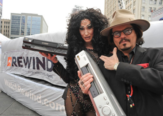 Johnny Depp and Cher look-a-likes helped launch Canada's newest speciality channel REWIND, featuring movies from the '70s, '80s and '90s, at Yonge-Dundas Square today. The channel, which starts with a free 60 day preview December 1 on major cable carriers, is holding National REWIND Your VCR Day Jan. 5, collecting old VCRs for charity. (CNW Group/Rewind)