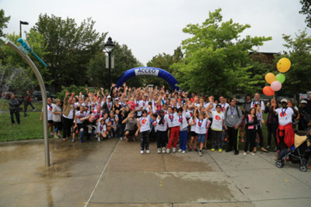 The participants of ACCEO's Race for the Children cross the finish line, having raised 105,500 dollars for the community social pediatrics movement. (CNW Group/ACCEO Solutions Inc.)