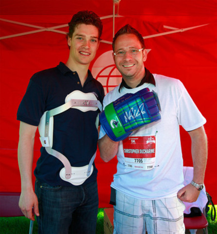 VANCOUVER, BC - JUNE 26, 2011: Vancouver Canuck forward and Honourary Chair of the Scotiabank Group Charity Challenge, Mason Raymond (L) meets Chris Ducharme, President of the British Columbia Bereavement Helpline, and top Scotiabank fundraiser. (CNW Group/Scotiabank - Sponsorships & Donations)