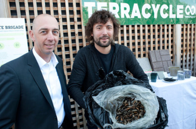 Tom Szaky, founder and CEO of TerraCycle (right), struts his butts to Eric Gagnon of Imperial Tobacco Canada on June 19 in Toronto. With help from collectors across Canada, TerraCycle gathered more than five million cigarette butts in the first year of its Cigarette Waste Brigade program. (CNW Group/TerraCycle Canada Inc.)