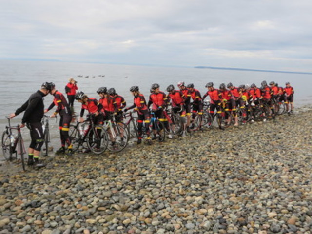 Sears National Kids Cancer Ride national cyclists dip their rear wheels in the Pacific Ocean on September 7 as ...