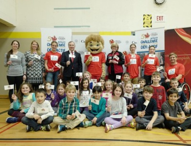 Hopewell Avenue Public School, Ottawa ON is Canada's first elementary school to sign up for the Canada Games Activity Challenge! Registration is now open: www.canadagames.ca/activitychallenge. L-R: Back: Physical Education Teacher Renee Labrosse, Principal Amy Hannah, student Teagan Stewart, Tom Quinn, Chairman of the Canada Games Council, Mascot Eddie, Hon.Carla Qualtrough, Noah Porter-MacLennan, Charlie Frank, Ambassador and Paralympian, Bo Hedges. Front: Grade 3 students. (CNW Group/Canada Games Council)