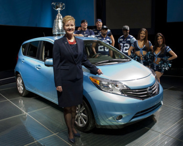 Judy Wheeler, Director of Marketing, Nissan Canada and the 100th Grey Cup winning Toronto Argonauts, at the Canadian debut of the all-new Nissan Versa Note in Toronto (CNW Group/Nissan Canada Inc.)