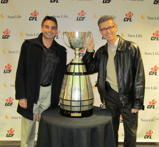 Afsar Shah, Assistant Vice-President, Career Sales Force, and Dave McKee, Vice-President and Associate General Counsel, revelled in the glory of the Canadian Football League (CFL) Grey Cup at Sun Life Financial on Thursday, November 10 in Waterloo. The Grey Cup's appearance at the company's Canadian Headquarters was part of the recently announced Sun Life sponsorship of the CFL. (CNW Group/Sun Life Financial Inc.)