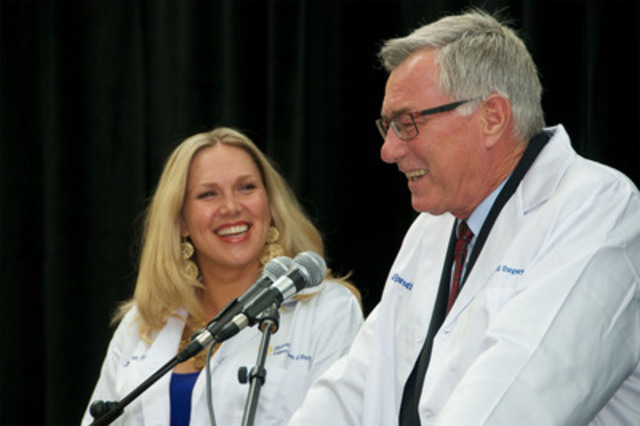 Eric Sprott, with his daughter Juliana Sprott, announces a $25 million gift to name the Sprott Department of Surgery at University Health Network. (CNW Group/Toronto General & Western Hospital Foundation)