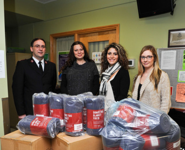 "Urban Barn Barrie location employees deliver brand-new blankets to the Salvation Army Barrie Bayside Mission as part of the national retailer's ""Blanket the Country in Warmth"" program. (L to R): Barrie Bayside Mission Executive Director Major Byron Kean, Barrie Urban Barn Sales Associate Teasha VanDerBurgt, Barrie Urban Barn Manager Gillian Ippolito, Barrie Urban Barn Sales Associate Ally Teitler. (CNW Group/Urban Barn)"
