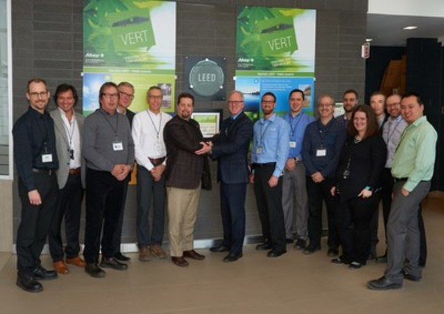A part of the Sobeys Québec team in front of the new LEED® silver certification rating, Sobeys Québec distribution centre in Terrebonne. (CNW Group/IGA)
