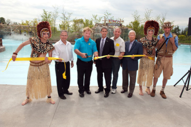 Official inauguration of the river Kongo Expedition at Calypso Theme Waterpark. Surrounded by African dancers as well as Wildman Jack, from left to right: Mr. François St-Amour, mayor of The Nation, Mr. Guy Drouin, President and CEO of Calypso Theme Waterpark, Mr. Grant Crack, MPP for Glengarry-Prescott-Russell, Mr. Marcel Legault, municipal councillor for The Nation and Mr. Jean-Marc Lalonde, former MPP for Glengarry-Prescott-Russell. (CNW Group/Calypso Park)