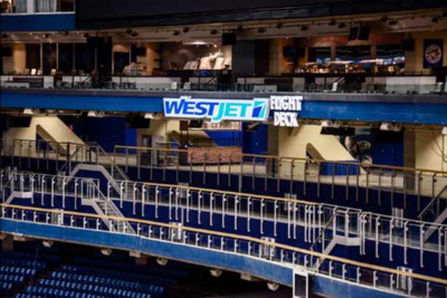 "WestJet and the Toronto Blue Jays announced a renewed partnership agreement today, featuring a newly-branded fan area called the ""WestJet Flight Deck"" located directly under the main video board in centrefield at Rogers Centre. (CNW Group/WestJet)"