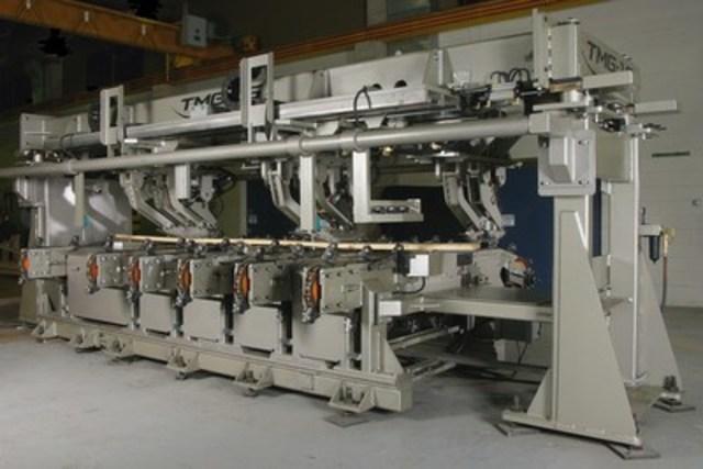 Le TMG (Transversal MSR Grader), un équipement conçu par le CRIQ servant à la classification du bois par contrainte mécanique. (Groupe CNW/Centre de recherche industrielle du Québec)