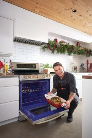 Chef Chuck Hughes, the new ambassador for LG Home Appliances, cooks up a storm with the new LG ProBake Convection™ range. (CNW Group/LG Electronics Canada)