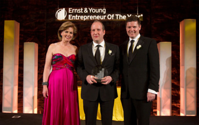 Ernst & Young Canada's chairman and chief executive officer Trent Henry (right) and Entrepreneur Of The Year program director Colleen McMorrow (left) honour Dani Reiss (centre) of Canada Goose Inc. with National Entrepreneur Of The Year award. (CNW Group/Ernst & Young)