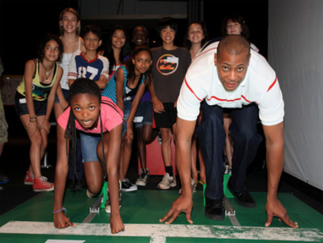 Toronto Raptor Jamaal Magloire getting ready to race against students from Shaughnessy Public School at the preview of SPORT, a new exhibition at the Ontario Science Centre, opening June 25. (CNW Group/Ontario Science Centre)