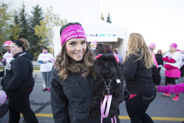 Dana Cole, WestJet employee, supporting the CIBC Run for the Cure with her furry friend. (CNW Group/WestJet)