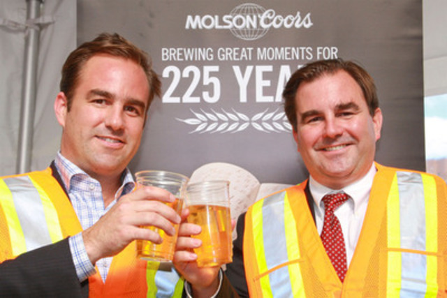 Seventh generation Molson brothers, Geoff and Andrew, toast to Molson Coors' 225 years of brewing with employees at the Vancouver brewery. To mark the milestone, the brothers are on tour across Canada. The Western tour kicked off in Vancouver and ends today in Calgary. They visit Atlantic Canada next week (CNW Group/MOLSON COORS CANADA)