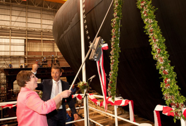 Mrs. Bernice Hynes, wife of Executive Chairman and the vessel's Godmother, officially names and christens the vessel, the Oceanex Connaigra. (CNW Group/OCEANEX INC.)