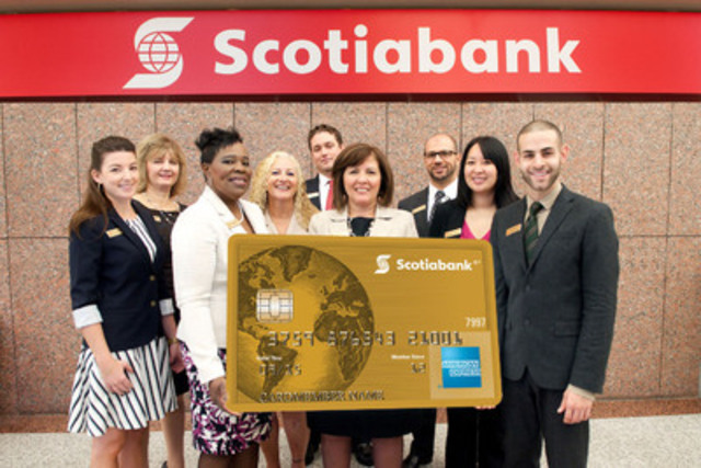 Just landed! Scotiabank employees at the 392 Bay Street branch in Toronto, Ontario celebrate the arrival of the new Scotiabank American Express® Cards - a suite of loyalty cards designed for travel enthusiasts. (CNW Group/Scotiabank - Products & Services)