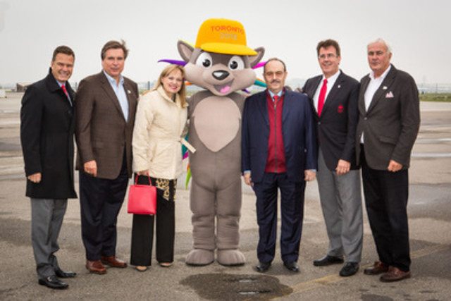 Don Mario Vázquez Raña, President of PASO (fifth from left), and his wife Doña Paquita de Vázquez Raña (third from left) arrive in Toronto on Sunday at Landmark Aviation - YYZ and are welcomed by (left to right) Christopher Overholt, CEO Canadian Olympic Committee; Ian Troop, CEO TO2015; PACHI, TORONTO 2015 mascot; Gordon Peterson, Vice-President Canadian Olympic Committee; and David Peterson, Chair TO2015. The Pan American Sports Organization (PASO) is the governing body for the TORONTO 2015 Pan American Games. (CNW Group/Toronto 2015 Pan/Parapan American Games)