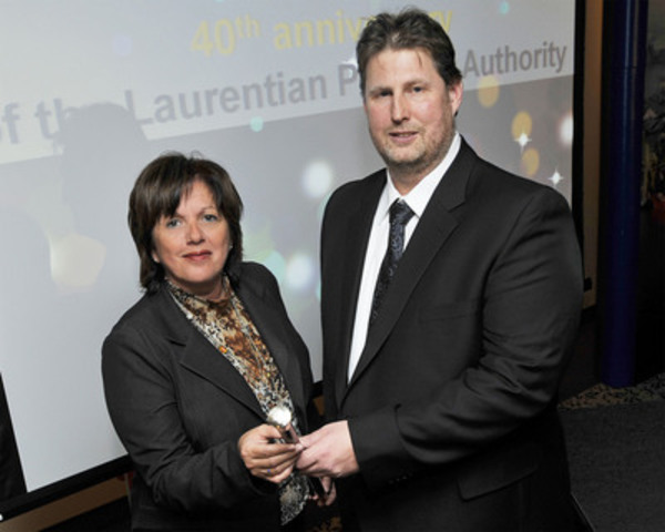 Montreal Port Authority President and Chief Executive Officer, Sylvie Vachon (left) awarding, Tuesday, the Gold-Headed Cane to Capt. Jendrik Fuerstenberg, master of the m.t. Seasprat, the first ocean-going vessel in port of Montreal in 2012 (CNW Group/PORT OF MONTREAL)