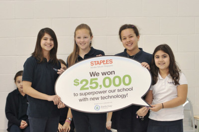 Left to right – Students, Ava Ammendolia, Alina Jurcic, Paulina Szczepanski and Alessia DiTomaso, hold up a sign indicating that their school, St. Marguerite d'Youville Catholic Elementary School, has won $25,000 worth of technology through the 2016 Staples Canada Superpower your School Contest. They are being recognized for their eco efforts. (CNW Group/Staples Canada Inc.)