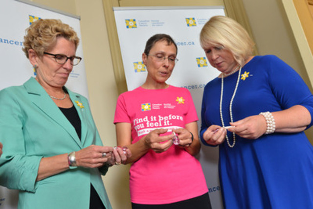 Ontario Premier Kathleen Wynne and Health Minister Deb Matthews learn about the importance of regular mammograms from breast cancer survivor and Women to Women ambassador Janice Hodgson to launch the Canadian Cancer Society's new Women to Women movement at Queen's Park on October 1. (CNW Group/Canadian Cancer Society (Ontario Division))