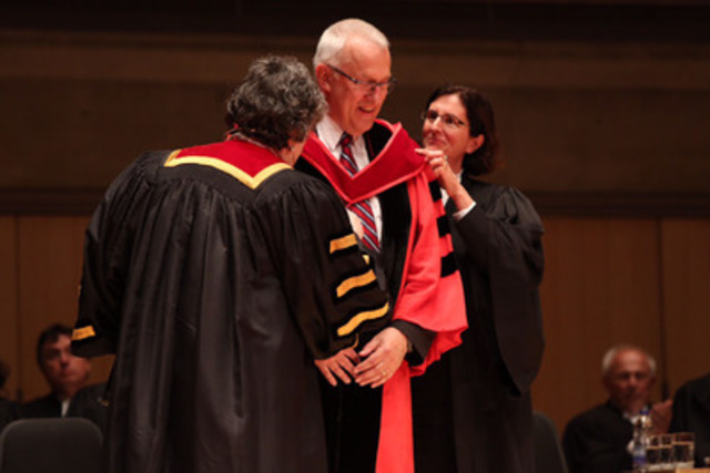 James K. Stewart (centre) was conferred with the Doctor of Laws honoris causa by Law Society Treasurer Janet E. Minor (left) this afternoon at the June 26th Call to the Bar ceremony at Roy Thomson Hall. Stewart is pictured here after receiving the ceremonial hood from Bencher Teresa Donnelly (right) (CNW Group/The Law Society of Upper Canada)