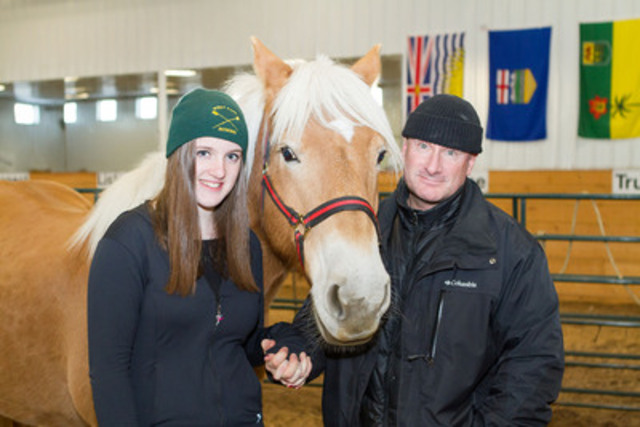 Tegan Vickers and her dad, Neil Vickers, a serving member of the Canadian Armed Forces with Bella the horse at the Can Praxis Equine centre in Rocky Mountain House. (CNW Group/Wounded Warriors Canada)