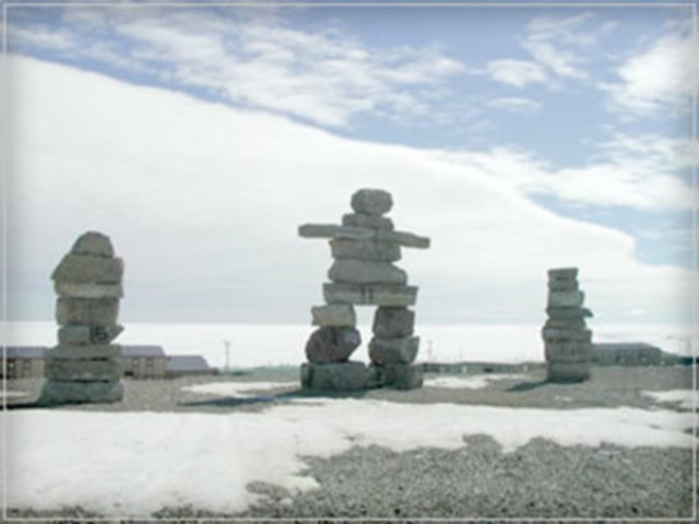 Igloolik's famous three Inuksuks warmly welcome visitors to town. ©spiritmaster.com. (CNW Group/Arctic Kingdom Polar Expeditions Inc.)