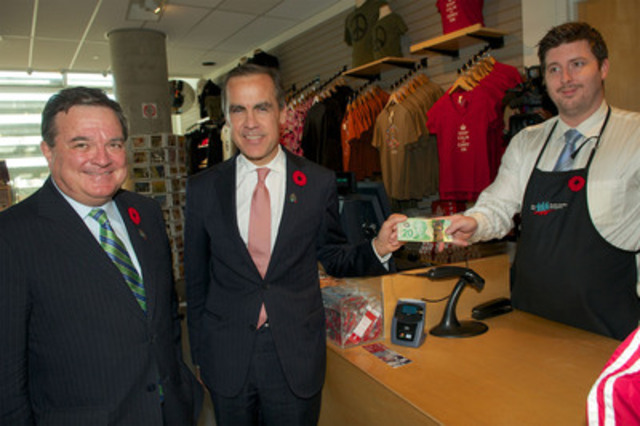 "Governor of the Bank of Canada Mark Carney and Finance Minister Jim Flaherty making their first purchase with their ""Vimy 20"" - (CNW Group/Vimy Foundation)"