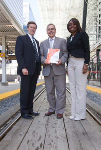 CivicAction Chair John Tory Metrolinx CEO Bruce McCuaig and CivicAction CEO Mitzie Hunter with the Our Region Our Move report (CNW Group/CivicAction)