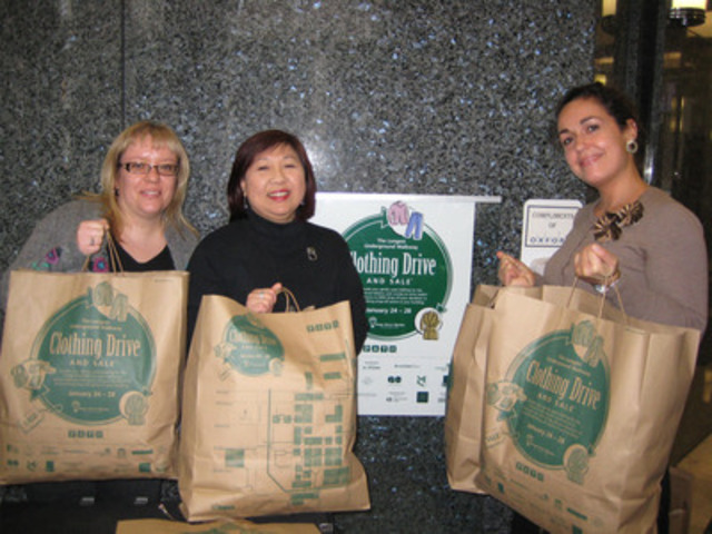 Volunteers collect bags of clothing at the 2012 clothing drive. (CNW Group/Yonge Street Mission)