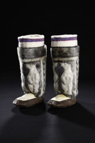 Arctic Bay, Nunavut, 1987: Fur inlay is a technique used by Inuit seamstresses to create highly intricate designs. A difficult challenge when creating this type of decoration is matching the nap of the different furs used to create the design so that all the hairs lie in the same direction. Collection of the Bata Shoe Museum. Photo credit: Image © 2016 Bata Shoe Museum, Toronto, Canada (photo: Ron Wood)  (CNW Group/Bata Shoe Museum)