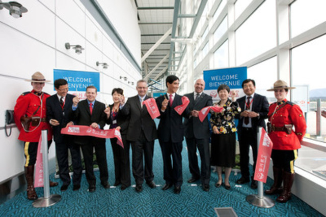 Representatives celebrate Sichuan Airlines' first flight from interior China to North America at Vancouver International Airport (YVR). From left to right: Mr. Zhou Xiding, Liaoning Deputy Director of National Development and Reform Commission; Tony Gugliotta, Sr. Vice President, Marketing and Business Development, Vancouver Airport Authority; Madam Zhang Yuan, Chair, Shenyang Taoxian Airport; The Honourable Ed Fast, Minister of International Trade and Minister for the Asia-Pacific Gateway; Mr. Lan Xinguo, Chairman of Sichuan Airlines; The Honourable Blair Lekstrom, British Columbia's Minister of Transportation and Infrastructure; The Honourable Liu Fei, Consul General with Ambassadorial Rank, The People's Republic of China in Vancouver; Mr. Li Haiying, President of Sichuan Airlines. (CNW Group/Vancouver Airport Authority)