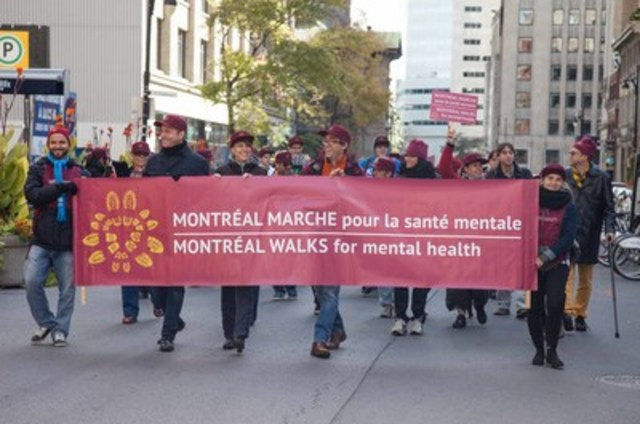 In the center of the picture appears spokeperson, Jessica Vigneault, along with other proud walkers, including Jasmin Roy, when walking 2015, on de Maisonneuve boulevard in Montreal. More than 1,500 people were there! (CNW Group/Montréal Marche pour la santé mentale)