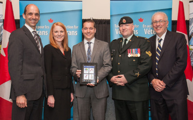 Minister Steven Blaney announces the national launch of a PTSD mobile app and funding for PTSD research. From left to right: Minister Blaney, Dr. Candice Monson (Professor and Principal Investigator, Ryerson University), Tim Laidler (Veteran and Executive Director, Veterans Transition Network), Master Corporal Wes Arscott and Sheldon Levy (President, Ryerson University). (CNW Group/Veterans Affairs Canada)