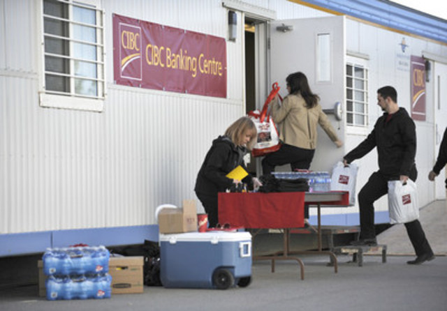 CIBC employees open a temporary banking centre to help Fort McMurray evacuees at Northlands Coliseum. (CNW ...