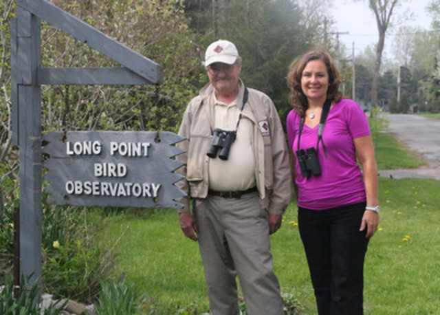George Finney (President of Bird Studies Canada) and Kathy Abusow (President & CEO of SFI, Inc.) pose for a photo at North America's longest running bird banding location - the Long Point Bird Observatory in Port Rowan, Ontario - in May 2014. Many birds pass through this location to forest habitats. (CNW Group/Sustainable Forestry Initiative Inc.)