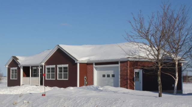 """The most efficient home in New Brunswick has been recognized with the """"Energuide Rating Service Most Efficient House"""" award. With an Energuide rating of 93, the house was manufactured by Maple Leaf Homes in Fredericton, NB. The company also built houses now arriving at the Attawapiskat First Nations community. (CNW Group/Maple Leaf Homes )"""