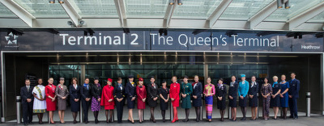 Staff in uniform from the Star Alliance airlines stand in front of the entrance to Terminal 2: The Queen's Terminal (CNW Group/STAR ALLIANCE)
