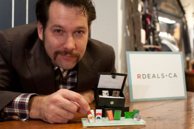 Neil McPhelan, co-founder of Toronto menswear store GreenShag, displays a selection of cufflinks to be featured on RDeals.ca this week. Rogers Digital Media announced today the launch of RDeals, a new daily deals site that brings local and national finds to Canadians for up to 90 per cent off the original price. (CNW Group/Rogers Media Inc.)