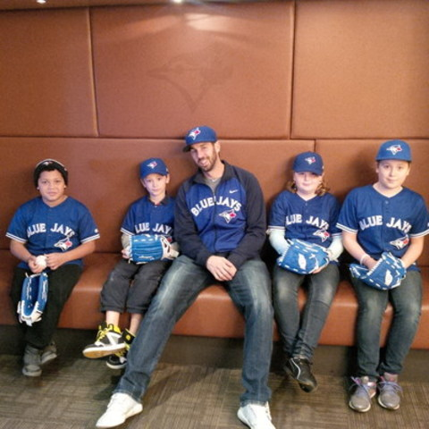 UPS delivers Toronto Blue Jays first baseman Chris Colabello. Chris hangs out with fans from Jays Care Foundation's Rookie League program from the Boys and Girls Club of Durham after a special behind-the-scenes tour of Rogers Centre. (CNW Group/UPS Canada Ltd.)