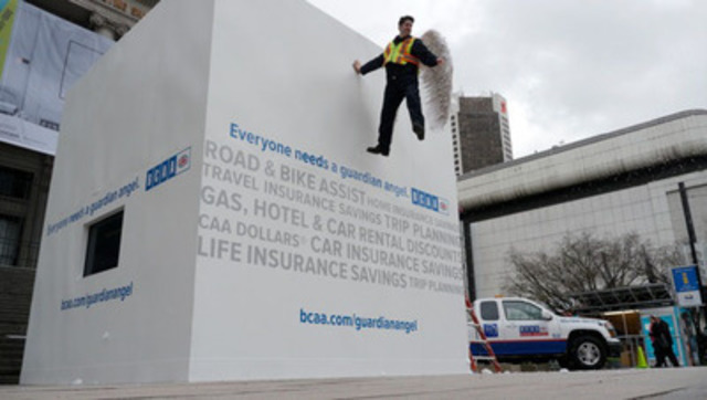 BCAA Guardian Angel illusion to help promote safe winter driving. The BCAA Guardian Angel is floating 16 feet in the air. (CNW Group/British Columbia Automobile Association)
