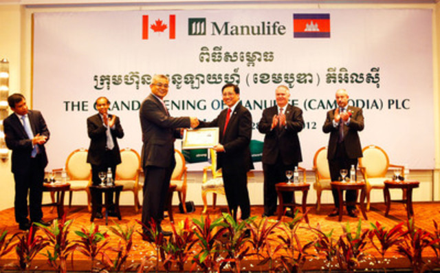 Presentation of Manulife (Cambodia) PLC licence by Dr. Aun Porn Muniroth, Minister attached to the Prime Minister, Secretary of State of Ministry of Economic and Finance to Mr. David Wong, Chairman of Manulife (Cambodia) PLC (CNW Group/Manulife Financial Corporation)