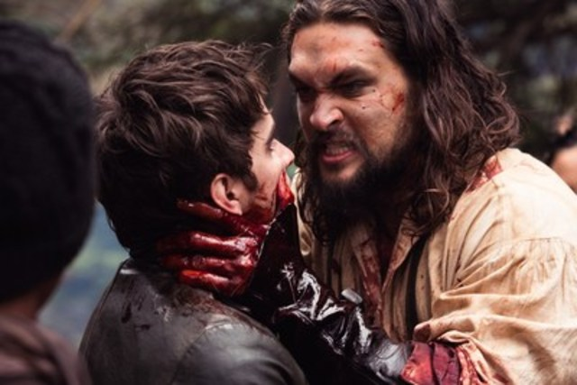 Michael Smyth (Landon Liboiron) and Declan Harp (Jason Momoa) in FRONTIER, the six-episode, one-hour drama from Discovery Canada series currently shooting in Newfoundland, Canada. FRONTIER follows the chaotic and violent struggle to control wealth and power in the North American fur trade of the late 18th century, created by Rob Blackie and Peter Blackie, directed by Brad Peyton. Photo credit: Duncan de Young. (CNW Group/Discovery)