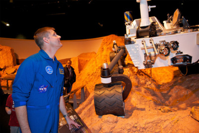 Canadian Space Agency Astronaut Jeremy Hansen admires a life-sized model of the Mars Rover Curiosity, part of the exhibition Beyond Planet Earth, at the Ontario Science Centre until January 1, 2013. Hansen was in town to speak at the Science Centre's Robots Rule event. Photo Credit: Ryan Emberley (CNW Group/Ontario Science Centre)