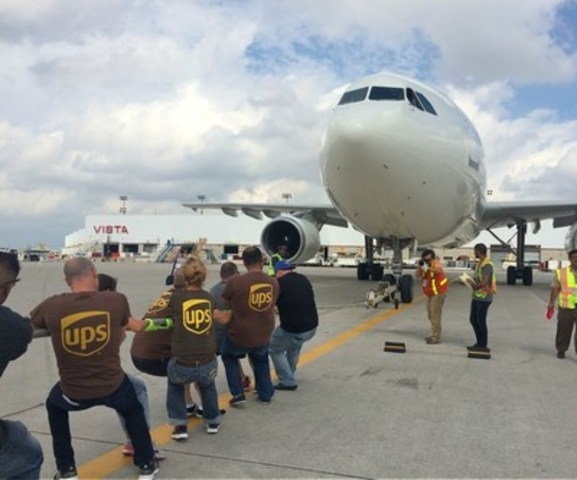 "On September 10, UPS Canada hosted the first annual ""Pulling for U"" plane pull event in support of United Way Peel Region at Toronto Pearson International Airport. A total of 14 teams came together to take on the challenge of pulling a UPS Airbus A300 50 feet across the tarmac in the shortest amount of time. The event will help fund local programs aimed at improving people's quality of life in Brampton, Caledon and Mississauga. (CNW Group/UPS Canada Ltd.)"
