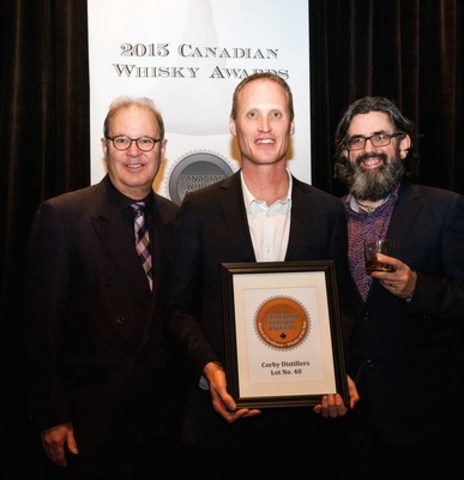 Dr. Don Livermore of Corby Distillers (centre) accepts the award for Canadian Whisky of the Year from Chairman of the Judges, Davin de Kergommeaux (left) and renowned whisky author, Dave Broom (right.) Lot No. 40 was named best whisky at the sixth annual Canadian Whisky Awards held January 14 at the Victoria Whisky Festival in Victoria, British Columbia, Canada. (CNW Group/Canadian Whisky Awards)
